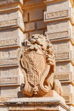 Lion statue with the coat of arms near Main Gate, Mdina. Stock Images
