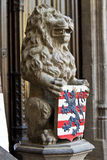 Lion statue with coat of arms Stock Photography