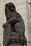 Lion statue with coat of arms Royalty Free Stock Photography