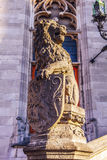 Lion statue with coat of arms shield. Royalty Free Stock Photography