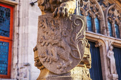 Lion statue with coat of arms shield. Stock Photo