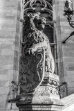 Lion statue with coat of arms shield. Black-white photo Royalty Free Stock Photos