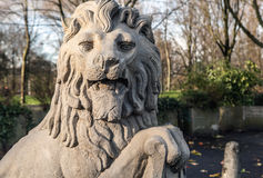 Lion statue with coat of arms shield. Royalty Free Stock Photos