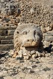 Lion statue at East Terrace on top of Nemrut Mountain.Turkey. Lion statue at East Terrace on top of Nemrut Mountain. Stone heads at the top of 2150 meters high stock image