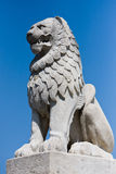 Lion Statue at Fisherman's Bastion. In Old Town, Budapest, Hungary.  Complete statue on its pedestal.  Grey stone, clear blue sky.  The lion is one of four Stock Images