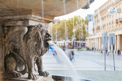 Lion statue and fountain on the square near Cologne cathedral Stock Photos