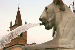 Lion Statue Fountain Water Jet. Lion fountain Sculpture & Bell TowerPiazza Venezia. Rome, Italy Stock Image