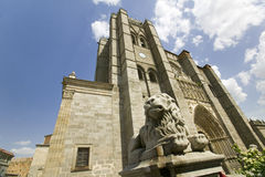 Lion statue in front of Catedral de �vila � �vila Cathedra, Cathedral of Avila, the oldest Gothic church in Spain in the old Stock Image