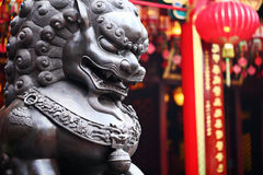 Lion statue in front of chinese temple Royalty Free Stock Photography