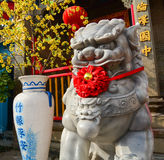 Lion statue in front of Chinese temple Royalty Free Stock Image