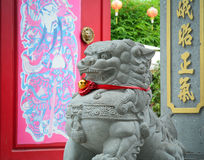 Lion statue in front of Chinese temple Stock Images
