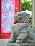 Lion statue in front of Chinese temple Stock Photography