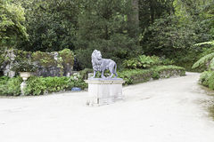 Lion statue in a garden Royalty Free Stock Photo