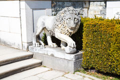 Lion Statue in the garden of Peles Castle, Romania Royalty Free Stock Photo