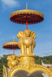 Lion statue. Golden Lion statue and blue sky background Royalty Free Stock Image