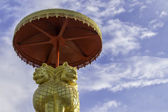 Lion statue. Golden Lion statue on blue sky background Stock Photos