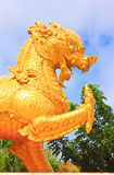 Lion statue. The golden Kirin statue stands in front of the church door Royalty Free Stock Photos