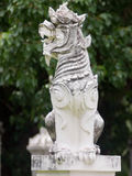 Lion statue. Heavy red lion statue and blue sky Stock Photo