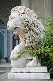 Lion statue with his paw on a sphere Royalty Free Stock Photo