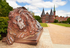 Lion statue and Holstein Gate at Lubeck Stock Photo