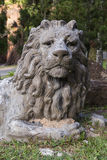 Lion statue inclining figure. Big and solid statue for decoration in the garden Stock Image
