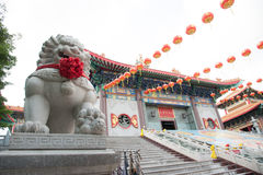 Lion statue located in front of Chinese temple, Stock Images