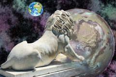 Lion statue looking at earth. White lion statue looking at blue earth in open cosmos stock image