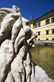 Lion statue looking at the entrance of the Hellbrunn castle Stock Images