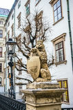 Lion statue near Hofburg Royal Palace in Vienna Royalty Free Stock Images