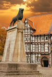 Lion statue and old timbered house in Braunschweig. Germany at sunset stock photos