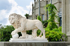 Lion statue outside a castle Stock Image