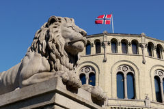 Lion statue outside the norwegian parliament Stock Photo