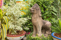 lion statue in park at Wat Mai Kham Wan temple, Phichit, Thailand royalty free stock images
