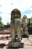 Lion statue at Phimai Historical Park. Lion statue made from sand stone at Phimai Historical Park Royalty Free Stock Image