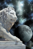 Lion statue and planet in open cosmos Royalty Free Stock Images