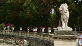 A Lion Statue and Potted Flowers at the Luxembourg Gardens