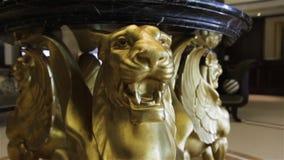 Lion statue sculpture. Luxury gold table interior design stock video footage
