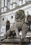 Lion statue with shield Royalty Free Stock Photos