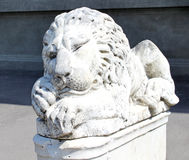 Lion statue sits on it`s pedestal Royalty Free Stock Photo