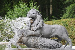 Lion Statue Spitting Water Stock Images