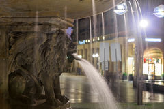 Lion statue with streaming water from mouth near Cologne cathedr Royalty Free Stock Photos