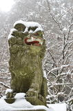 Lion Statue at Temple in Winter Royalty Free Stock Photos