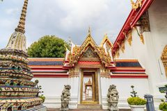 The Lion statue of Thai-Chinese architecture Keep the arch at Wat Pho. Stock Image