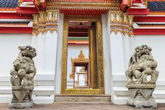 The Lion statue of Thai-Chinese architecture lion statue at Wat. The Lion statue of Thai-Chinese architecture Keep the arch at Wat Pho.Landmark of Bangkok Stock Images