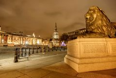 Lion Statue at Trafalgar Square at night  in London, UK. London, UK- January 11, 2018:Lion Statue at Trafalgar Square at night  in London, UK Royalty Free Stock Photography