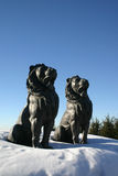 Lion Statue. Two lion statues sitting proudly in the snow guarding the village entrance Stock Images