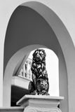 Lion statue under arches Royalty Free Stock Images