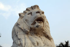 Lion Statue, Victoria Memorial Gate, Kolkata,. Antique Lion Statue in sky background at Victoria Memorial Gate, Kolkata, India. Built with hite Makrana Marbles Royalty Free Stock Photos
