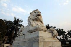 Lion Statue at Victoria Memorial, Kolkata. Antique Lion Statue in sky background at Victoria Memorial Gate, Kolkata, India. Built with white Makrana Marbles Stock Images