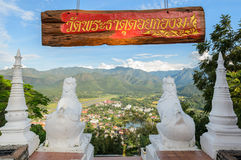 Lion statue at Wat Phra That Doi Kong Mu with city view of Mae H Royalty Free Stock Photos